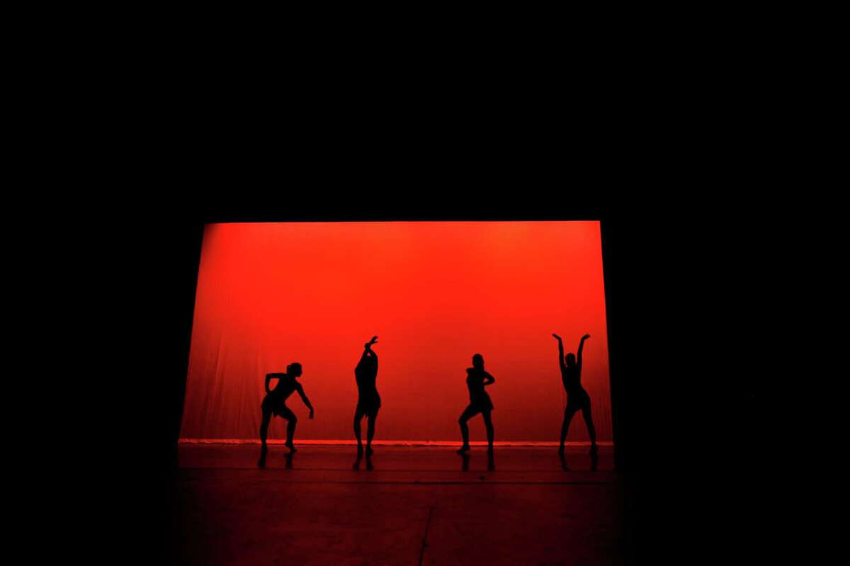 """Dancers perform a run through of """"Back to Black,"""" choreographed by Lena Jacobson, during the tech rehearsal for the 5th Annual Young Choreographers Festival on Dec. 12, 2015. Dancers Amanda Cadenhead, Maggie Elsen, Kelly Ferguson, Laura Ferguson, Julia Golden, Cassie Marriot, Clare McGinnis, Maggie McGinnis, Cameron Murphy, Anna Sellon and Kristen Walsh from East Pointe Dance perform the routine."""