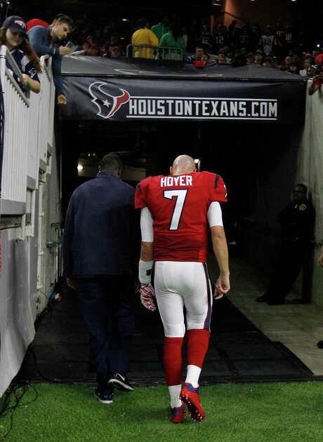 Texans quarterback Brian Hoyer exits the field and enters the NFL's concussion protocol for the second time this season after taking a fourth-quarter hit. Photo: Karen Warren, Staff / © 2015  Houston Chronicle