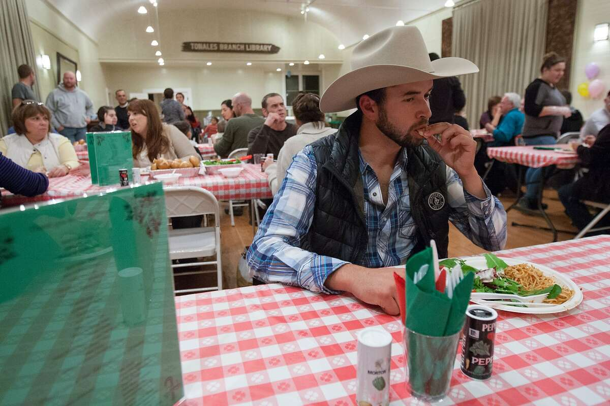 Israel Plascencia of Valley Ford takes a bite from his plate, which consists of tri-tip, spaghetti, bread and salad at Tomales Town Hall, Saturday, Dec. 12, 2015, in Tomales, Calif. The 12th annual crab feed fundraiser for Shoreline Acres Preschool replaced its crab offering with tri-tip.