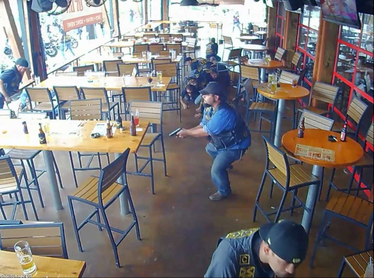 In this image made from surveillance video, members of a motorcycle club react to a shooting at a Twin Peaks restaurant in Waco, Texas on May 17, 2015. On Friday, Oct. 30, 2015, The Associated Press published surveillance video and photos of the Twin Peaks restaurant where the deadly shooting occurred. The release comes nearly six weeks after AP reviewed more than 8,800 pages of evidence related to the confrontation.