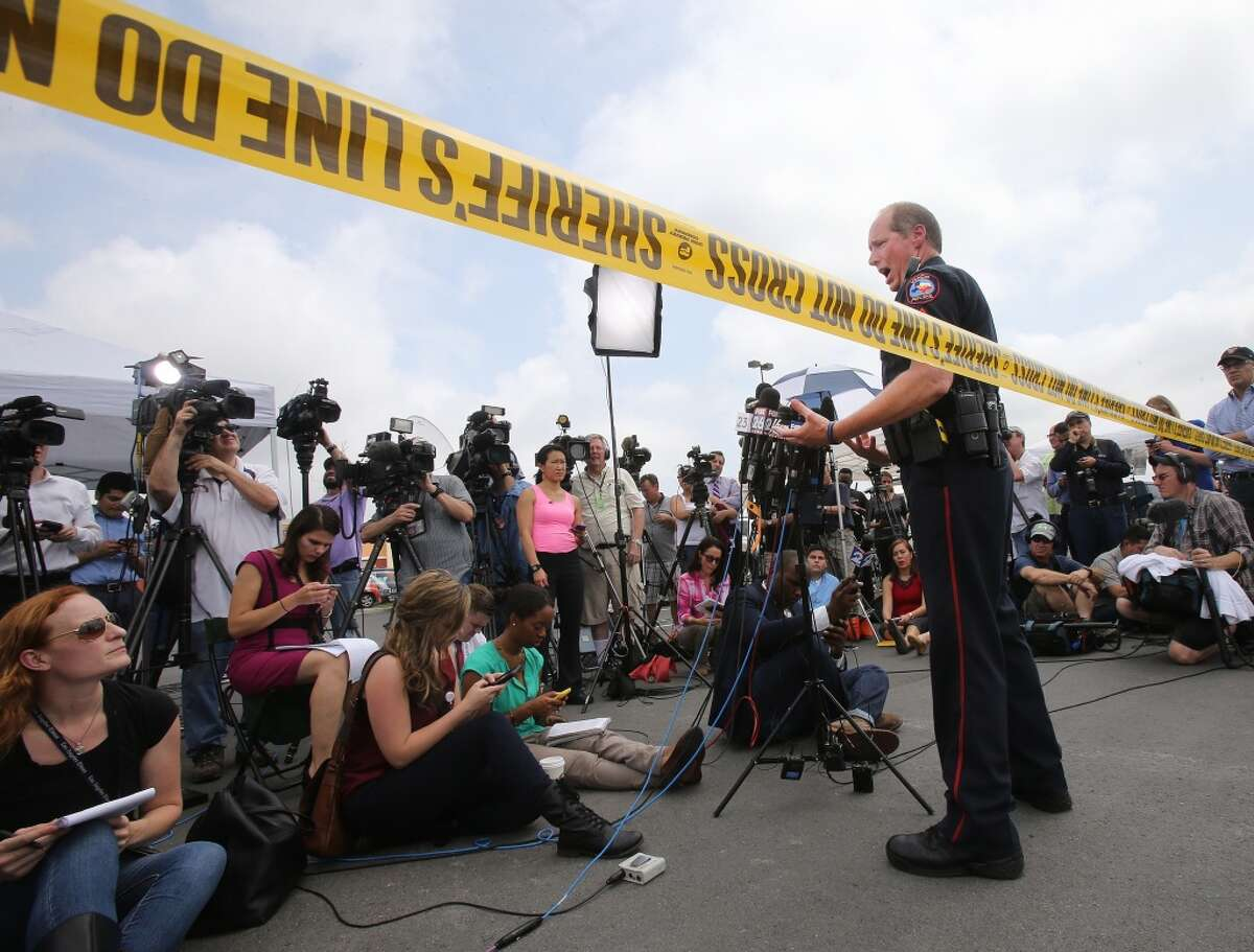 Waco Police Sgt. Patrick Swanton addresses the media as law enforcement continues to investigate the motorcycle gang-related shooting at the Twin Peaks restaurant, Monday, May 18, 2015, in Waco, Texas, where nine were killed Sunday and over a dozen injured. About 170 gang members were charged with engaging in organized crime are each being held on a $1 million bond and authorities say charges of capital murder are expected in the wake of the Central Texas shooting. (AP Photo, Jerry Larson)