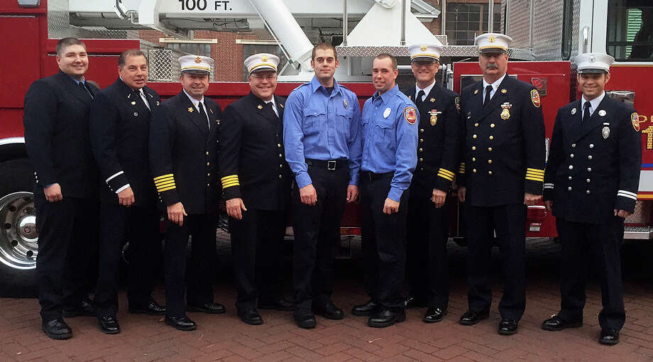 Probationary Firefighters Adam Gamble and Ronald Burgess are flanked by Fire Department officials following their recent from the Connecticut Fire Academyís recruit-training program. Photo: Contributed / Contributed Photo / Westport News