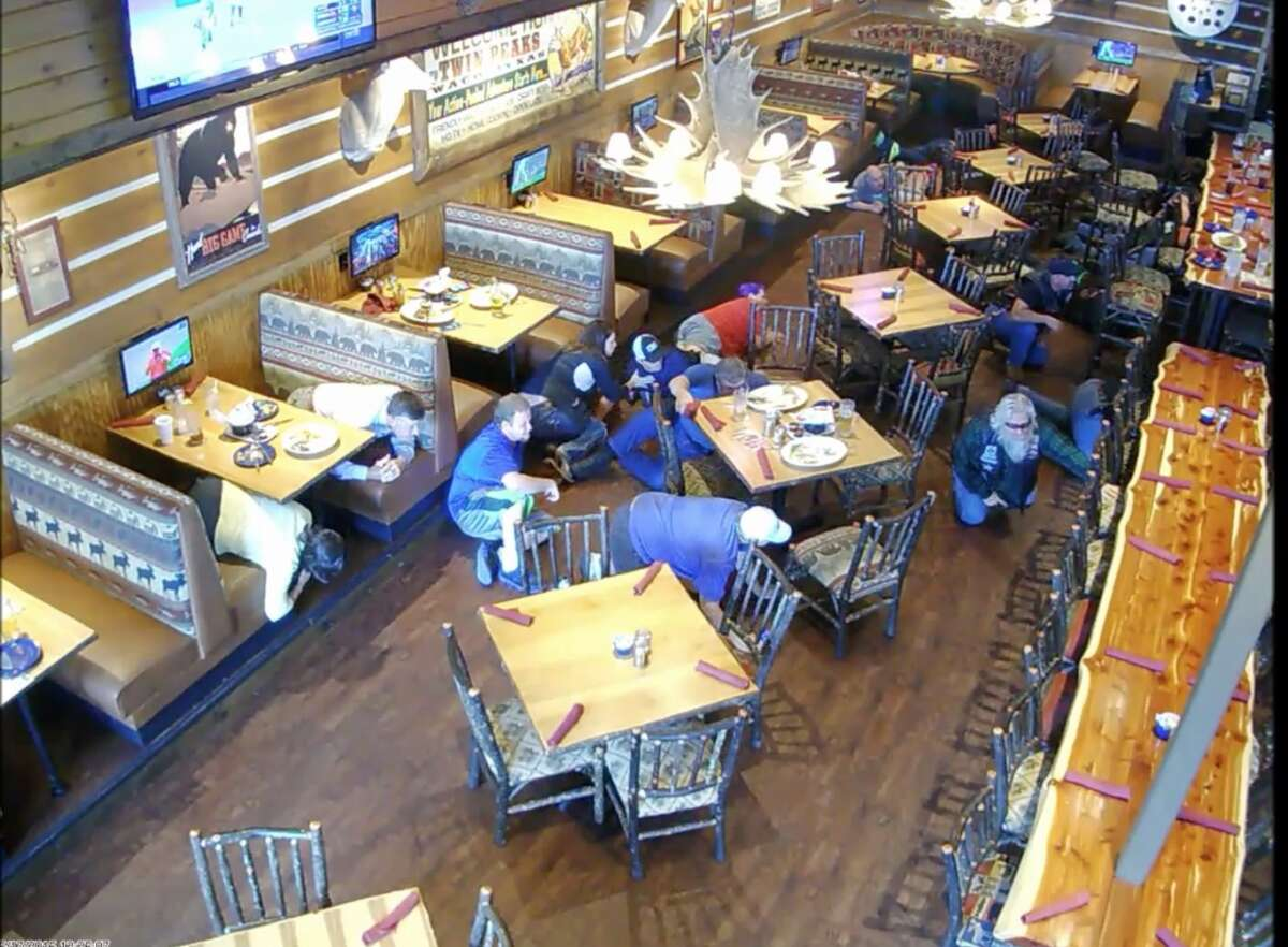 In this image made from surveillance video, people react to a shooting at a Twin Peaks restaurant in Waco, Texas, on May 17, 2015. On Friday, Oct. 30, 2015, The Associated Press published surveillance video and photos of the Twin Peaks restaurant where the deadly shooting occurred. The release comes nearly six weeks after AP reviewed more than 8,800 pages of evidence related to the confrontation. (AP Photo)