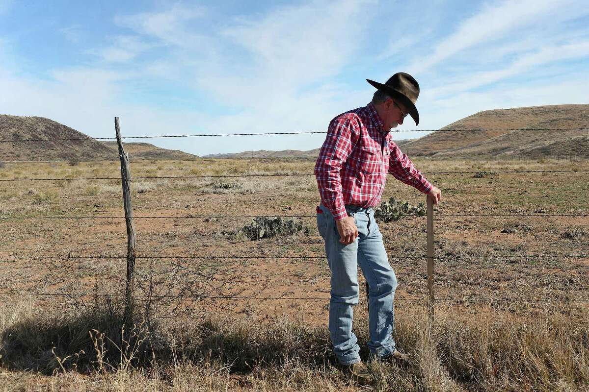 """While working cattle, Joel Nelson checks out a marker for the Trans-Pecos Pipeline, Project that runs one-mile through the north part of his ranch near Alpine, Texas, Wednesday, Dec. 9, 2015. The Trans-Pecos Pipeline Project plans on running the pipe through a mile of Nelson's land. The pipeline will transport natural gas from a collection site west of Fort Stockton crossing the Big Bend area of Texas into Mexico upriver from Presidio. The pipeline is expected to cut through the middle of the valley behind him. ?'I?•ve told a lot of people that my opposition to the pipeline is in now way based on my one-mile stretch of land. I could live with that,?"""" he said. ?'It?•s the fact that it will go through some of the most beautiful open range country in Brewster and Presidio Counties, and it will disrupt and affect so many people. It?•s a scene I can?•t stand,?"""" he said."""