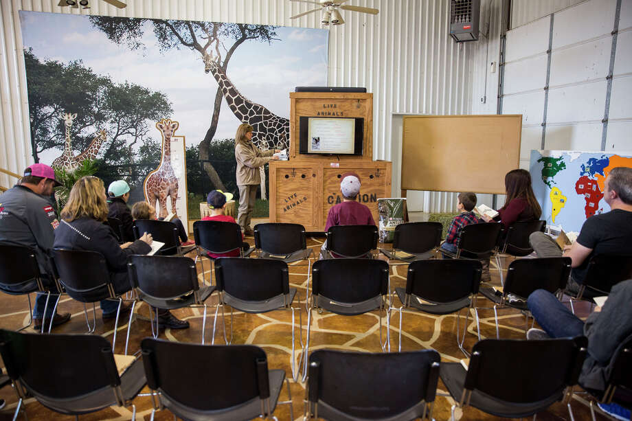 Tiffany Soechting teaches the Natural Bridge Wildlife Ranch's Giraffe Ambassador Class on Dec. 5. The a monthly one-hour workshop about giraffes held at the ranch between San Antonio and New Braunfels. Photo: Carolyn Van Houten /San Antonio Express-News / 2015 San Antonio Express-News