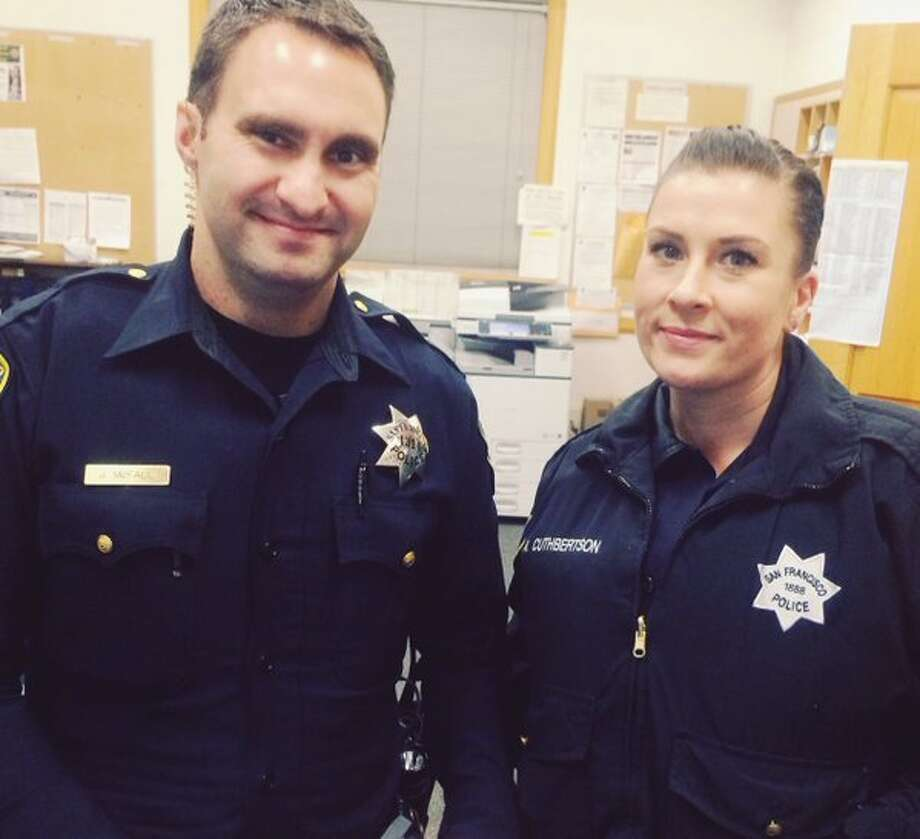 San Francisco police officer McFall (left) and Officer Cuthbertson (right) from the Richmond District have befriended an 84 year old woman who lives alone and has no family in the area. Photo: San Francisco Police Dept.