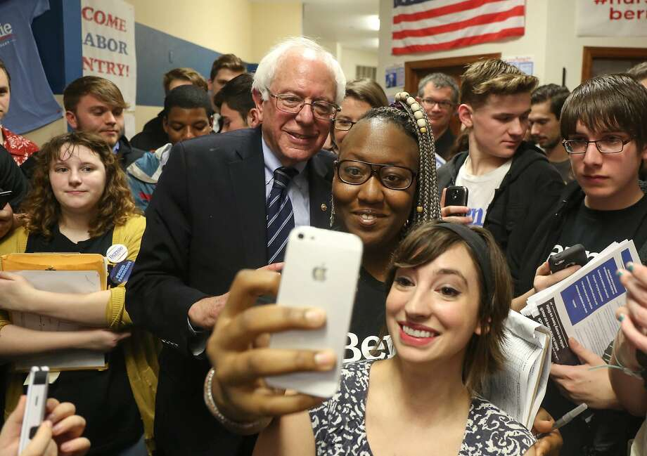 Bernie Sanders poses with supporters at his campaign office in Waterloo, Iowa. He trails Hillary Rodham Clinton overall, but he leads with first-time caucus-goers (49  to 40 percent). Photo: Bryon Houlgrave, Associated Press