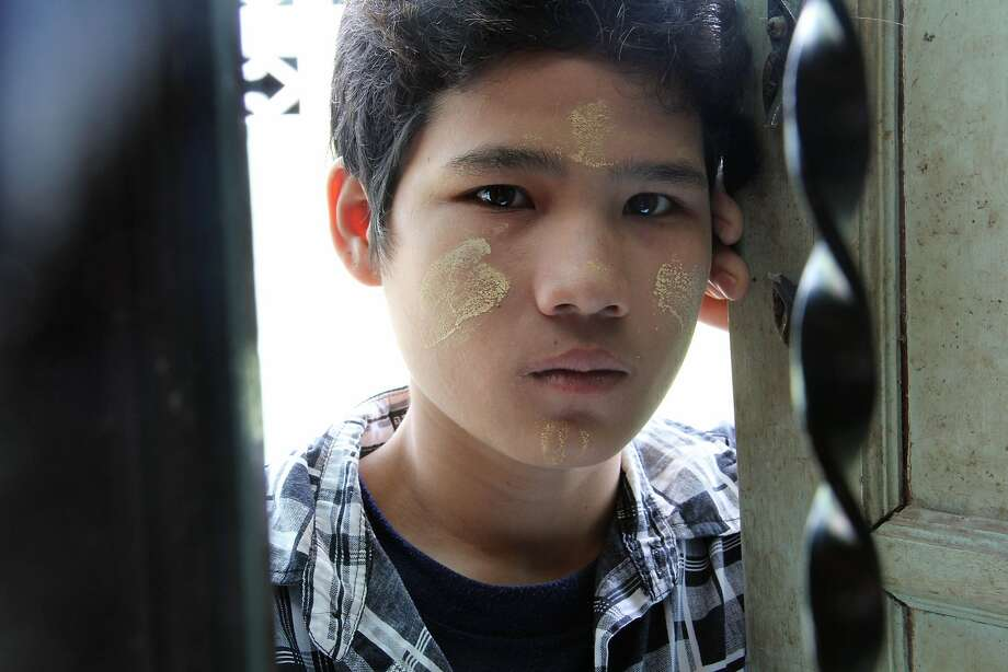 ADVANCE FOR USE MONDAY, DEC. 14, 2015 AT 12:01 A.M. EST (05:01 GMT) AND THEREAFTER - This Aug. 31, 2015 photo shows Soe Lay, 20, who worked in a shrimp shed in Samut Sakhon, Thailand. He says he couldn't leave because his migrant passport was taken by the shed's owner, and that he was once taken to the police station for stealing six pieces of shrimp to eat from the shed. (AP Photo/Esther Htusan) Photo: Esther Htusan, Associated Press