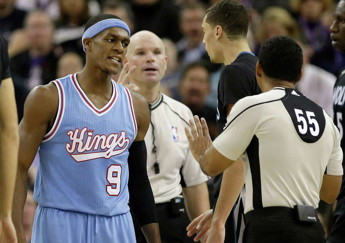 Sacramento Kings guard Rajon Rondo, left, questions official Bill Kennedy (55) about a foul call during the second half of an NBA basketball game against the Minnesota Timberwolves in Sacramento, Calif., Friday, Nov. 27, 2015. The Timberwolves won 101-91. (AP Photo/Rich Pedroncelli)