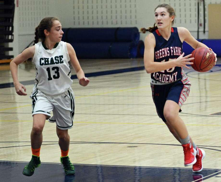 GFA junior captain Lexi Kimball, right, on a breakaway during the team's win over Chase Collegiate (59-25). Kimball already has 117 points and 23 steals in four games this season. Photo: Ryan Lacey/Staff Photo / Westport News Contributed