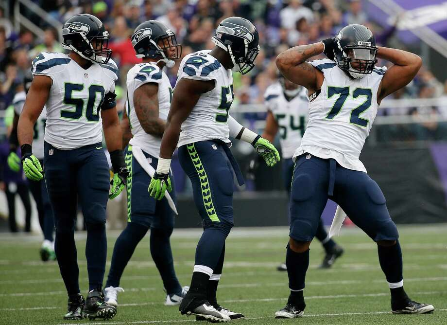 Defensive end Michael Bennett of the Seattle Seahawks celebrates after making a first half tackle against the Baltimore Ravens at M&T Bank Stadium on December 13, 2015 in Baltimore, Maryland. Photo: Rob Carr, Getty Images / 2015 Getty Images