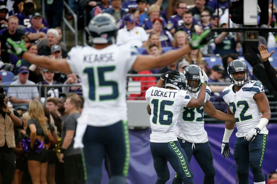 Wide receiver Doug Baldwin of the Seattle Seahawks celebrates with teammates wide receiver Tyler Lockett, running back Fred Jackson and wide receiver Jermaine Kearse after scoring a second-quarter touchdown against the Baltimore Ravens at M&T Bank Stadium on December 13, 2015 in Baltimore, Maryland. Photo: Rob Carr, Getty Images / 2015 Getty Images