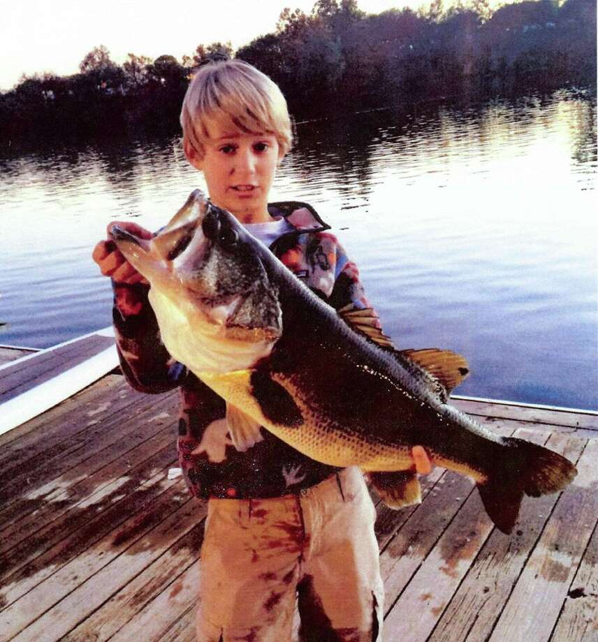 Grant Langmore, 13, caught this 13.5-pound, 27-inch largemouth bass from Lady Bird Lake. It is the new rod and reel Waterbody Record, Junior Waterbody Record, Junior Waterbody Release Record, and also earned Grant a Big Fish Award.