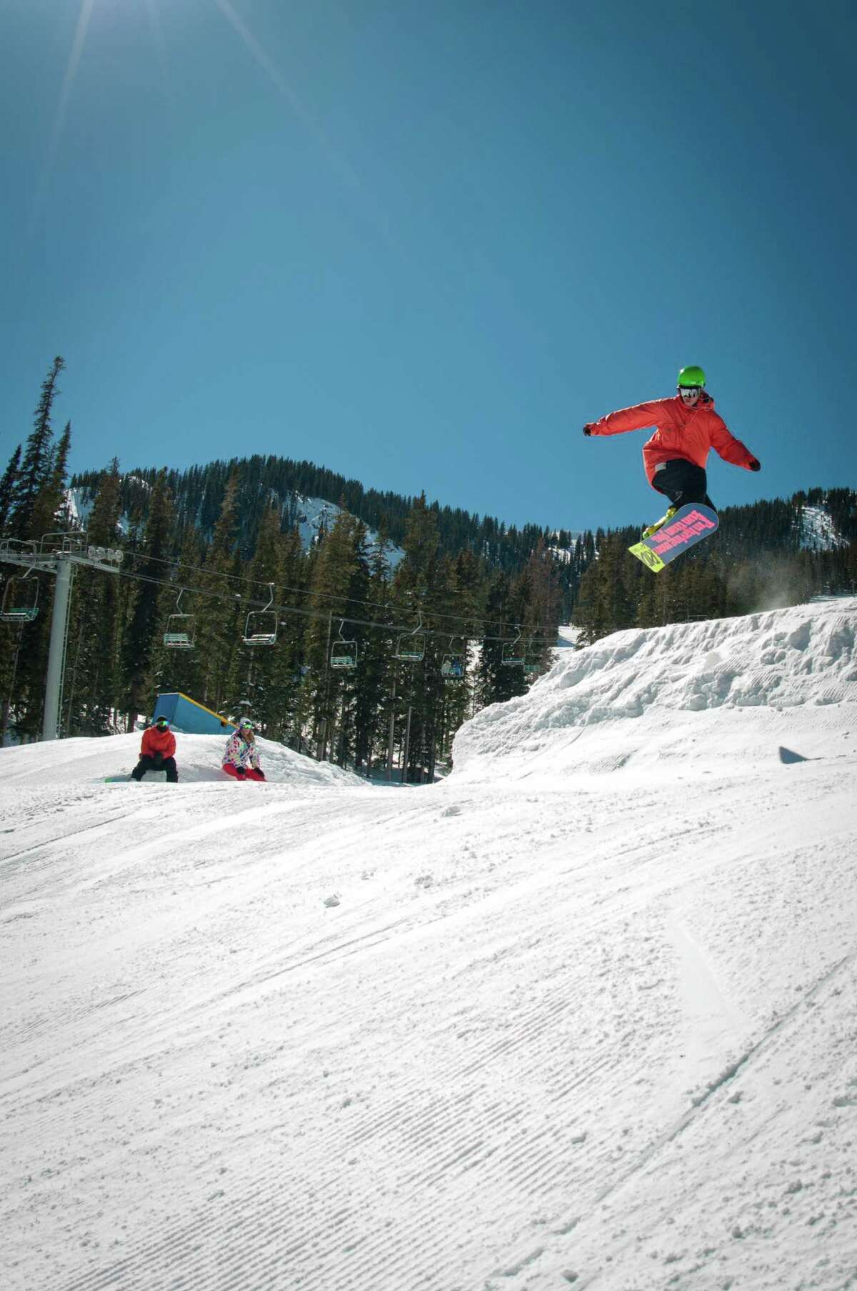 A snowboarder catches air at the resort in Taos, N.M. Taos Ski Valley is investing $300 million in the resort to update and expand its facilities. Improvements include a new lift to Kachina Peak, enhanced snowmaking, and modernized hotel, dining and shopping options. (Thatcher Dorn/Taos Ski Valley via AP)