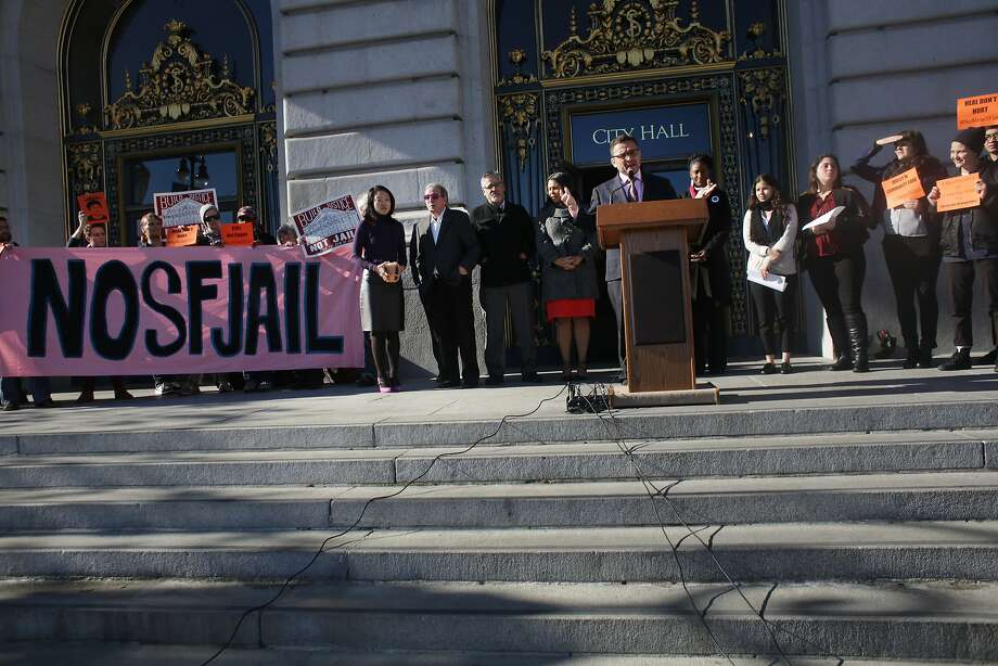 Supervisor David Campos (behind podium) speaks on the steps of City Hall during a press conference  opposing the proposal for a new jail in San Francisco on Monday, December 14,  2015 in San Francisco, Calif. Photo: Lea Suzuki, The Chronicle