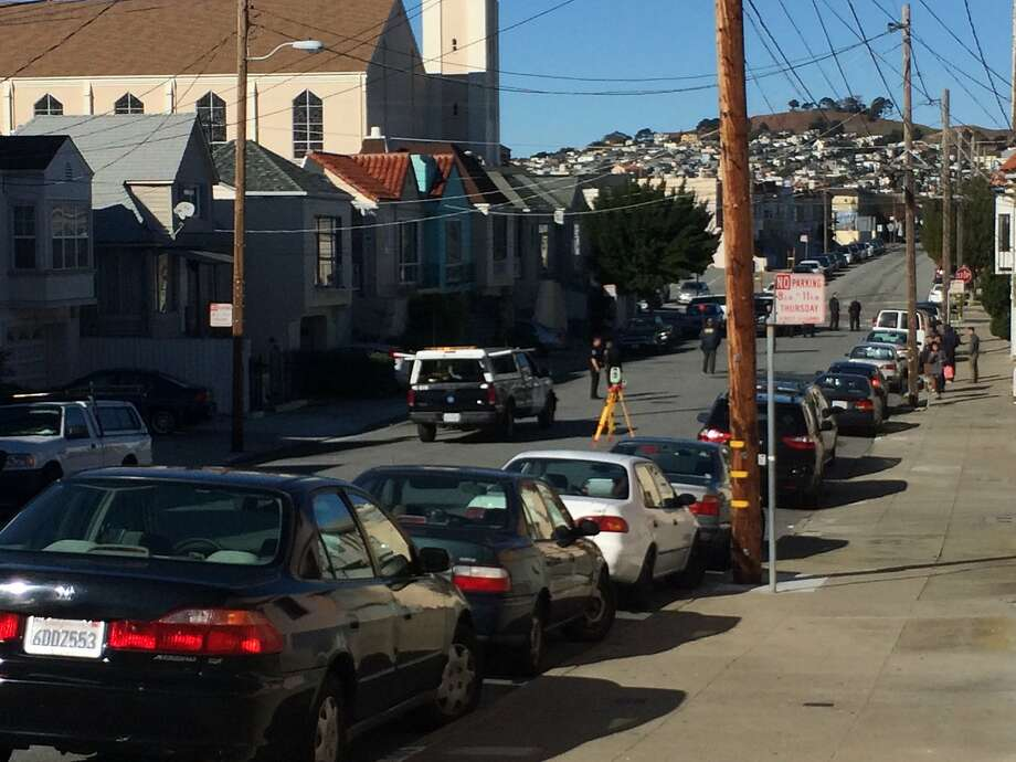 San Francisco police investigated a crash Monday morning in which a 63-year-old bicyclist was hit and killed by a car in the city's Portola neighborhood. Photo: Jenna Lyons