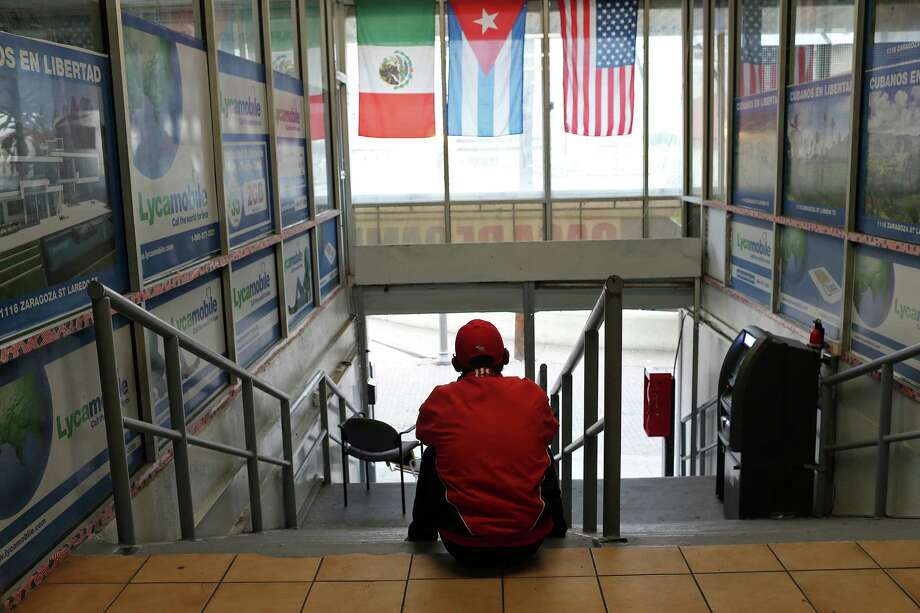 Cuban refugee Yuliecer Castro, 37, sits at the Cubanos en Libertad offices near the Laredo Port of Entry. A reader says it is time to end the preferential treatment Cubans receive when it comes to immigration. Photo: JERRY LARA /San Antonio Express-News / © 2015 San Antonio Express-News