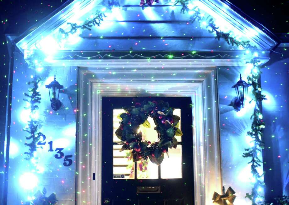 A wreath and Christmas lights great visitors to the Modern Southern-style house in Monticello Park owned by Jeffery James and his partner Justin Michaelson. Photo: Billy Calzada /San Antonio Express-News / San Antonio Express-News
