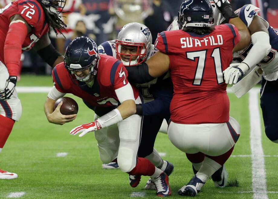Texans quarterback Brian Hoyer (7) is sacked by New England Patriots defensive tackle Dominique Easley (99) during the first half on Dec. 13, 2015, in Houston. Photo: David J. Phillip /Associated Press / AP