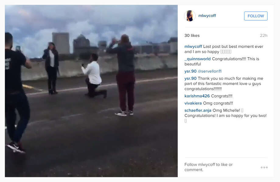 A video posted on Instagram on Sunday, Dec. 14, 2015, showed a man proposing to a woman on Interstate 45 near downtown Houston while others blocked traffic. (mlwycoff on Instagram) Photo: Mlwycoff On Instagram
