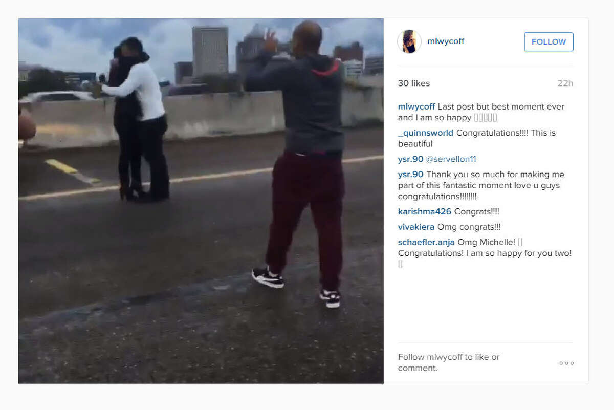 A video posted on Instagram on Sunday, Dec. 14, 2015, showed a man proposing to a woman on Interstate 45 near downtown Houston while others blocked traffic. (mlwycoff on Instagram)
