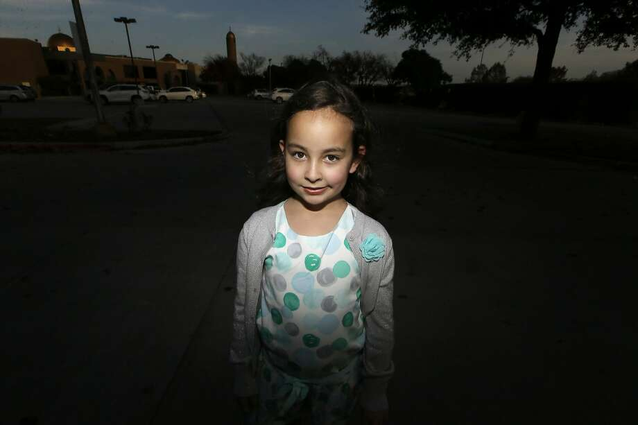 The talk of barring Muslims from the U.S. led Sofia Yassini, 8, to check the locks on her family's home in Plano, Texas. Photo: LM Otero, Associated Press