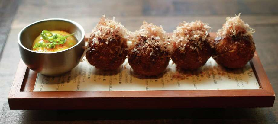 House-made Texas antelope meatballs topped with teriyaki sauce with shredded bonito flakes and raw egg yolk dip at Izakaya, 318 Gray, at the corner of Gray and Bagby, on Thursday, July 23, 2015, in Houston. ( Karen Warren / Houston Chronicle ) Photo: Karen Warren, Staff / © 2015 Houston Chronicle