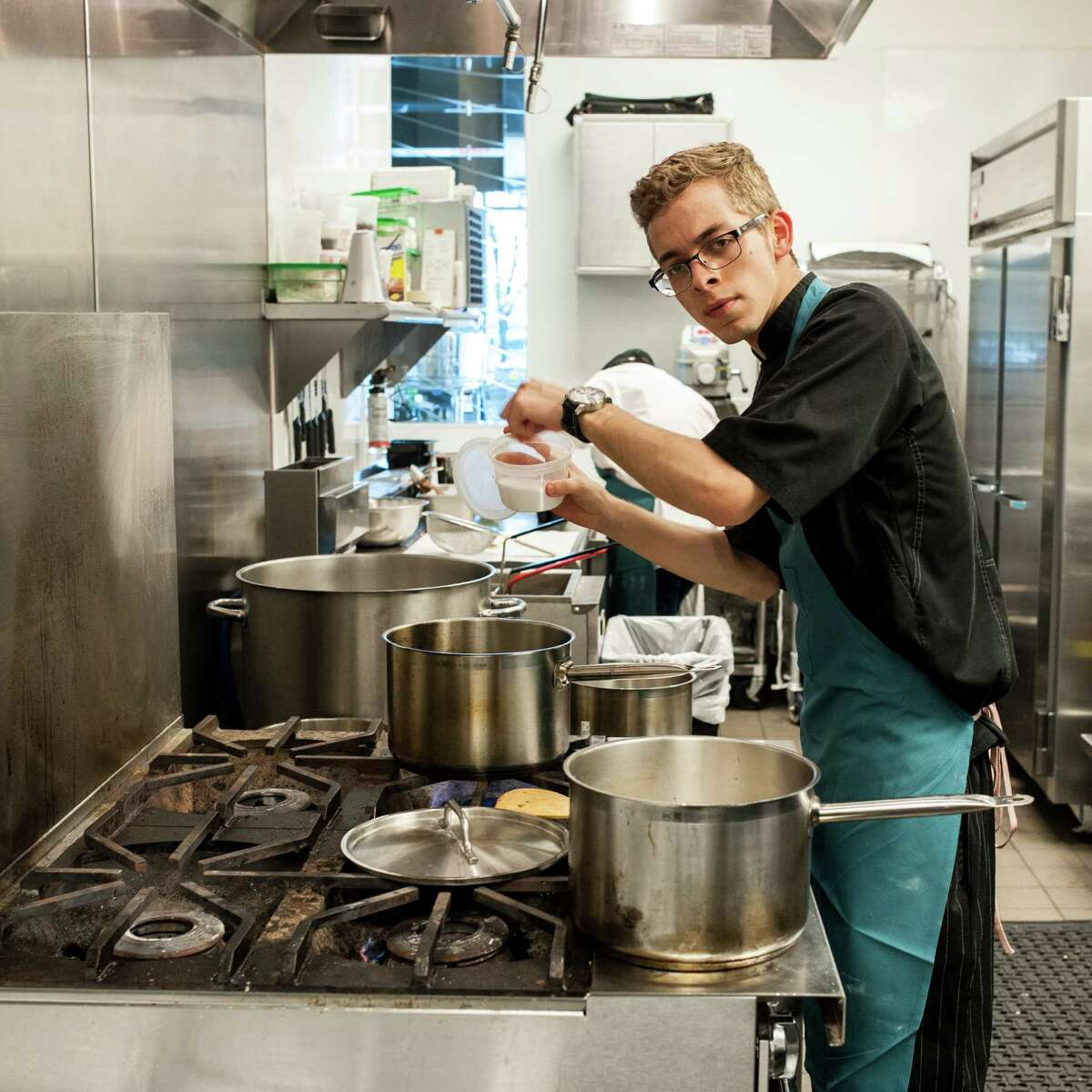 Chef Omar Pereney, shown in the kitchen at Peska Seafood Culture, has filed suit against his former employer. Click through to see scenes from his past work there.