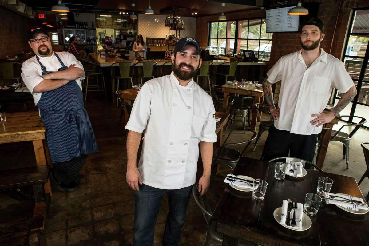Lyle Bento, executive chef, center, is flanked by JD Woodward, left, and Patrick Feges in the dining room at Southern Goods.