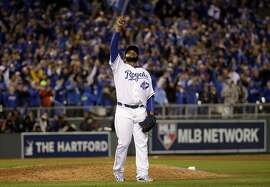 Kansas City Royals pitcher Johnny Cueto reacts after getting New York Mets' Yoenis Cespedes to fly out and end Game 2 of the Major League Baseball World Series Wednesday, Oct. 28, 2015, in Kansas City, Mo. The Royals won 7-1 to take a 2-0 lead in the series. (AP Photo/David J. Phillip)