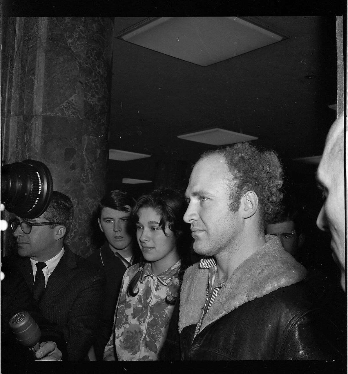 FILE-- Ken Kesey and Carolyn Adams found on a roof top with marijuana, on Jan. 19, 1966.