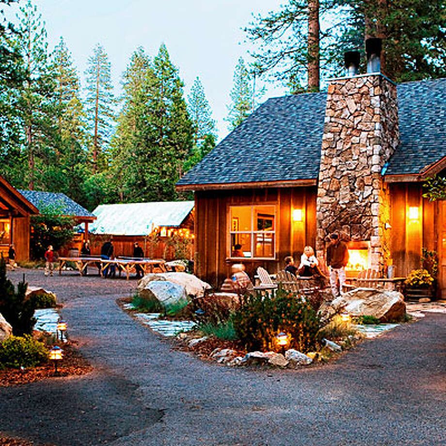 "Evergreen Lodge at YosemiteGroveland, CAWith 88 cabins scattered across 20 secluded acres, Evergreen Lodge is a short drive from Yosemite's west entrance. Built in the 1920s but nicely updated, the resort has a family-camp feel and wide range of accommodations. Our favorite options are the25 deluxe cabins with king-size beds, cast-iron gas fireplaces, and private decks. Two-bedroom family cabins come with sharedliving rooms. The owners, who offer a range of guided adventures including snowshoeing through sequoia groves, say winter is their favorite time of year in Yosemite: ""The pace is slower and the snow makes everything even more spectacular."" Cabins from $250; evergreenlodge.com Photo: Sunset.com"