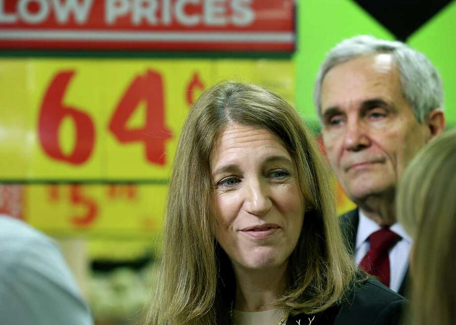 U.S. Department of Health and Human Services Secretary Sylvia Burwell, center, stopped in San Antonio last week to remind consumers to enroll in 2016 health insurance plans through the federal HealthCare.gov website. She visited with H-E-B employees at the San Antonio company's store on South New Braunfels. Congressman Lloyd Doggett, right, appeared with her. Photo: Express-News File Photo / San Antonio Express-News