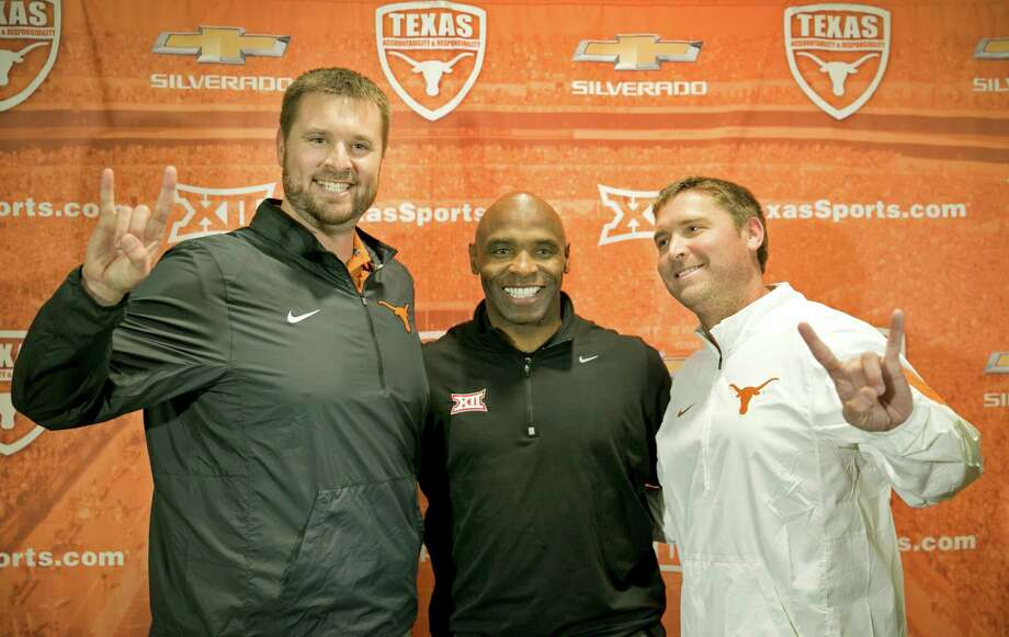 University of Texas NCAA college football head coach Charlie Strong, center, introduces two new assistant coaches, offensive line coach Mike Mattox, left, and offensive coordinator Sterlin Gilbert, during a news conference in Austin, Texas, Monday Dec. 14, 2015.  Photo: Jay Janner, Associated Press / Austin American-Statesman