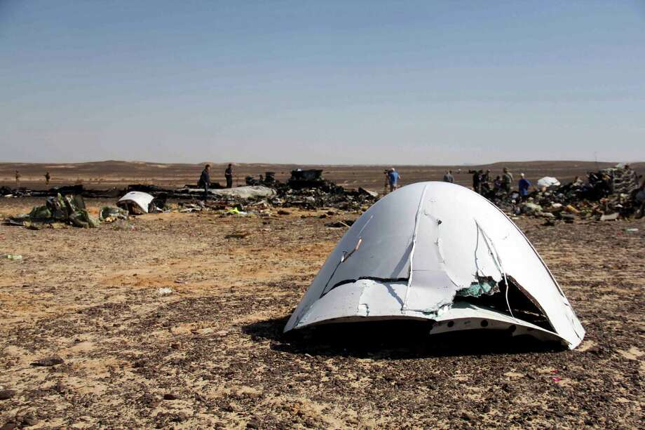 "FILE - In this Sunday, Nov. 1, 2015 file photo, Debris of a Russian airplane is seen at the site a day after the passenger jet bound for St. Petersburg, Russia, crashed in Hassana, Egypt. Egypt's chief investigator says a preliminary investigation into the October crash of a Russian passenger plane in Sinai has found no indication yet of any ""illegal or terrorist act."" (AP Photo, File) Photo: STR / AP"