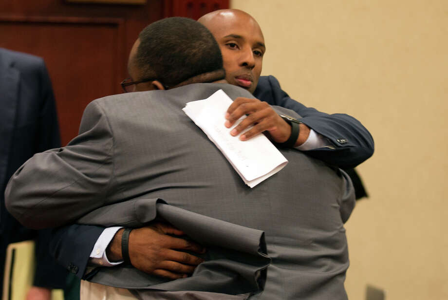 Jay High School principal Robert Harris (left) hugs former assistant football coach Mack Breed as they appear at a UIL hearing on Oct. 15, 2015, in Round Rock. Photo: Ricardo Brazziell /Associated Press / Austin American-Statesman