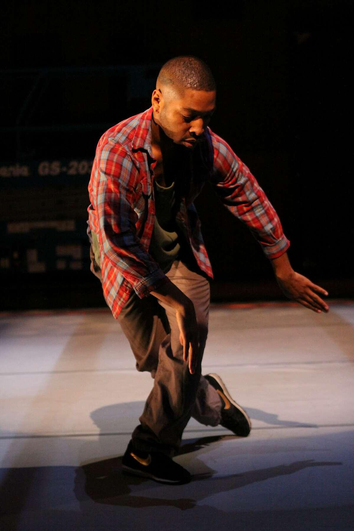 "Kyle Abraham dances in his ""Pavement."" Photo by Steven Schreiber"