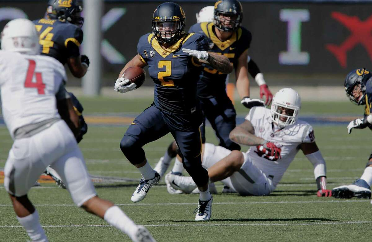 Cal's Daniel Lasco, 2 picks up ten yards on a second quarter run, as the California Bears take on the Washington State Cougars at Memorial Stadium in Berkeley, Calif., on Sat. October 3, 2015.