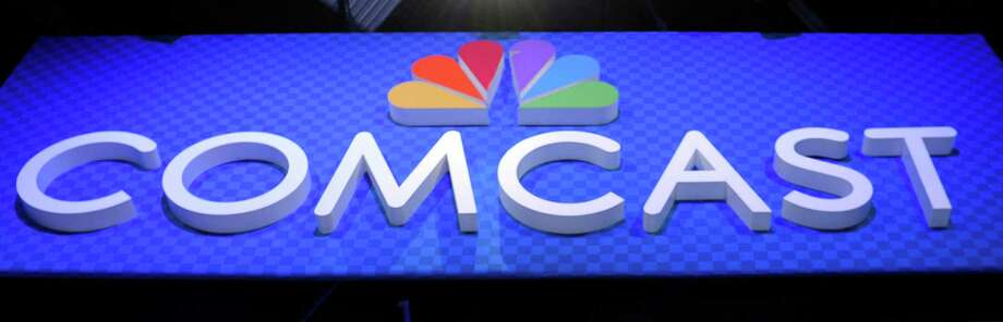 This June 11, 2013, file photo, shows the Comcast Corp. logo during The Cable Show 2013 convention in Washington. (AP Photo/Susan Walsh, File) Photo: Susan Walsh, STF / AP