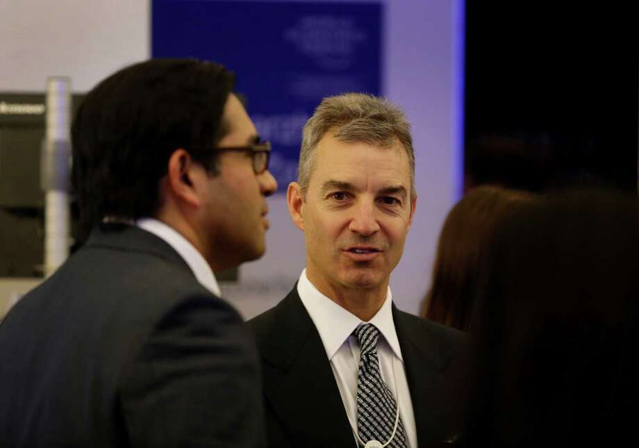 Daniel Loeb, right, CEO of Third Point, wants Dow Chemical Co.'s CEO removed. Loeb's firm has a  2 percent stake in Dow, according to FactSet.  Photo: Simon Dawson / Copyright 2013 Bloomberg Finance LP, All Rights Reserved.