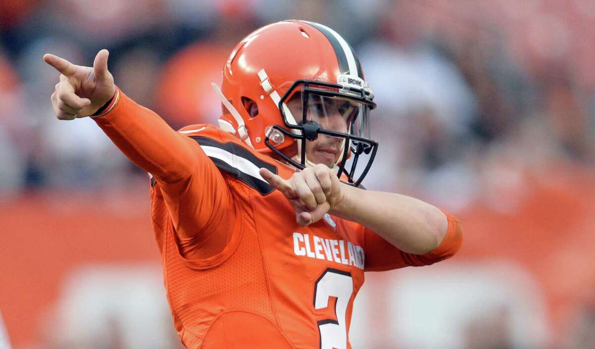 Browns quarterback Johnny Manziel signals a first down during the second half against the San Francisco 49ers on Dec. 13, 2015, in Cleveland.