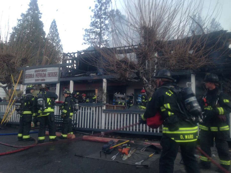 A fire broke out at the historic Sierra Nevada House in Coloma, Calif., on Monday, Dec. 14, 2015. Photo: Claire Doan, KCRA