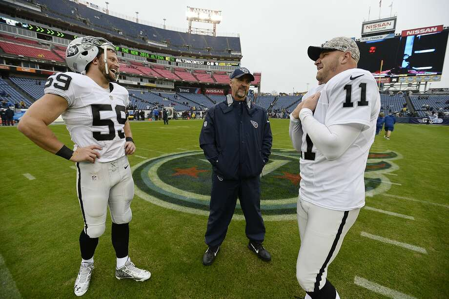 Long snapper Jon Condo (59) dislocated his shoulder, and was hurting when a bad snap led to a Sebastian Janikowski miss. Photo: Mark Zaleski, Associated Press
