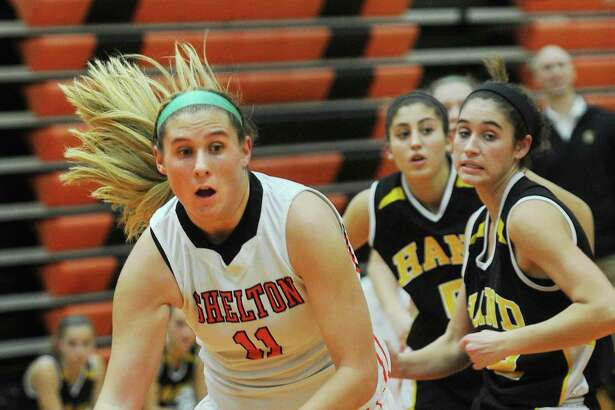 Shelton's Nicole Roberts drives to the basket during their girls basketball game with Hand at Shelton High School in Shelton, Conn. on Monday, December 14, 2015.