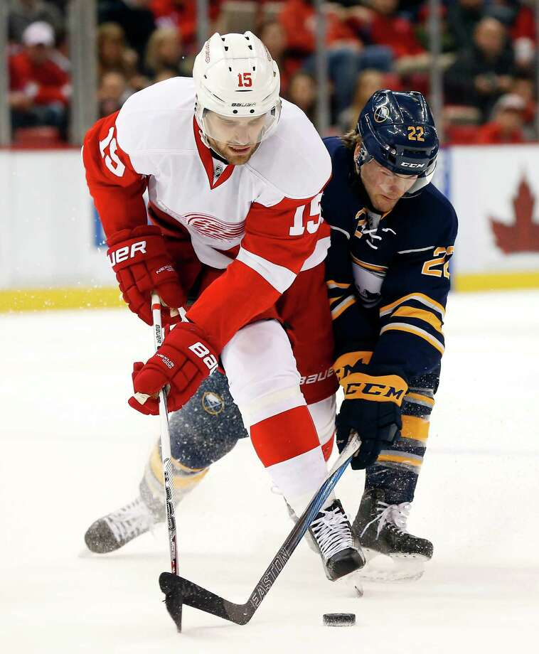 Detroit Red Wings Center Riley Sheahan Left And Buffalo Sabres Wing Johan Larsson