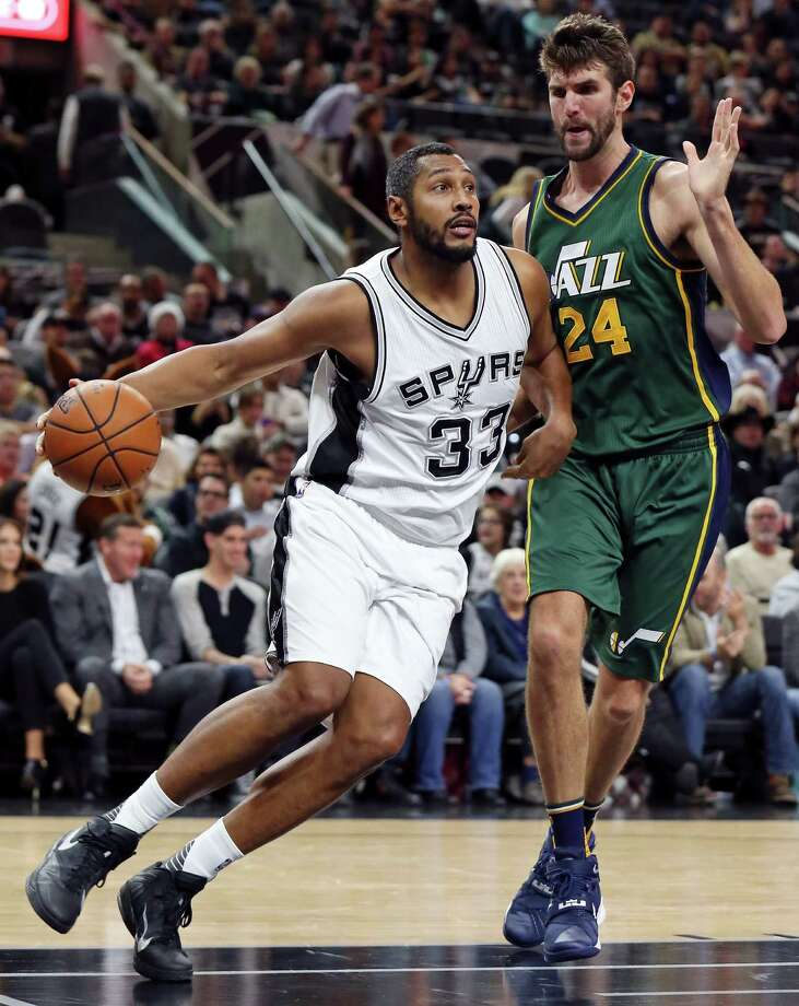San Antonio Spurs' Boris Diaw drives around Utah Jazz's Jeff Withey during first half action Monday Dec. 14, 2015 at the AT&T Center. Photo: Edward A. Ornelas, Staff / San Antonio Express-News / © 2015 San Antonio Express-News
