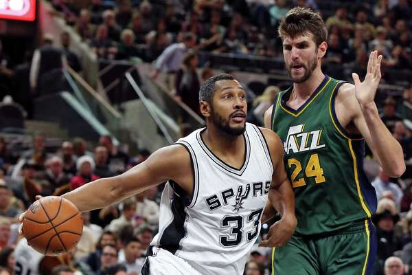 San Antonio Spurs' Boris Diaw drives around Utah Jazz's Jeff Withey during first half action Monday Dec. 14, 2015 at the AT&T Center.