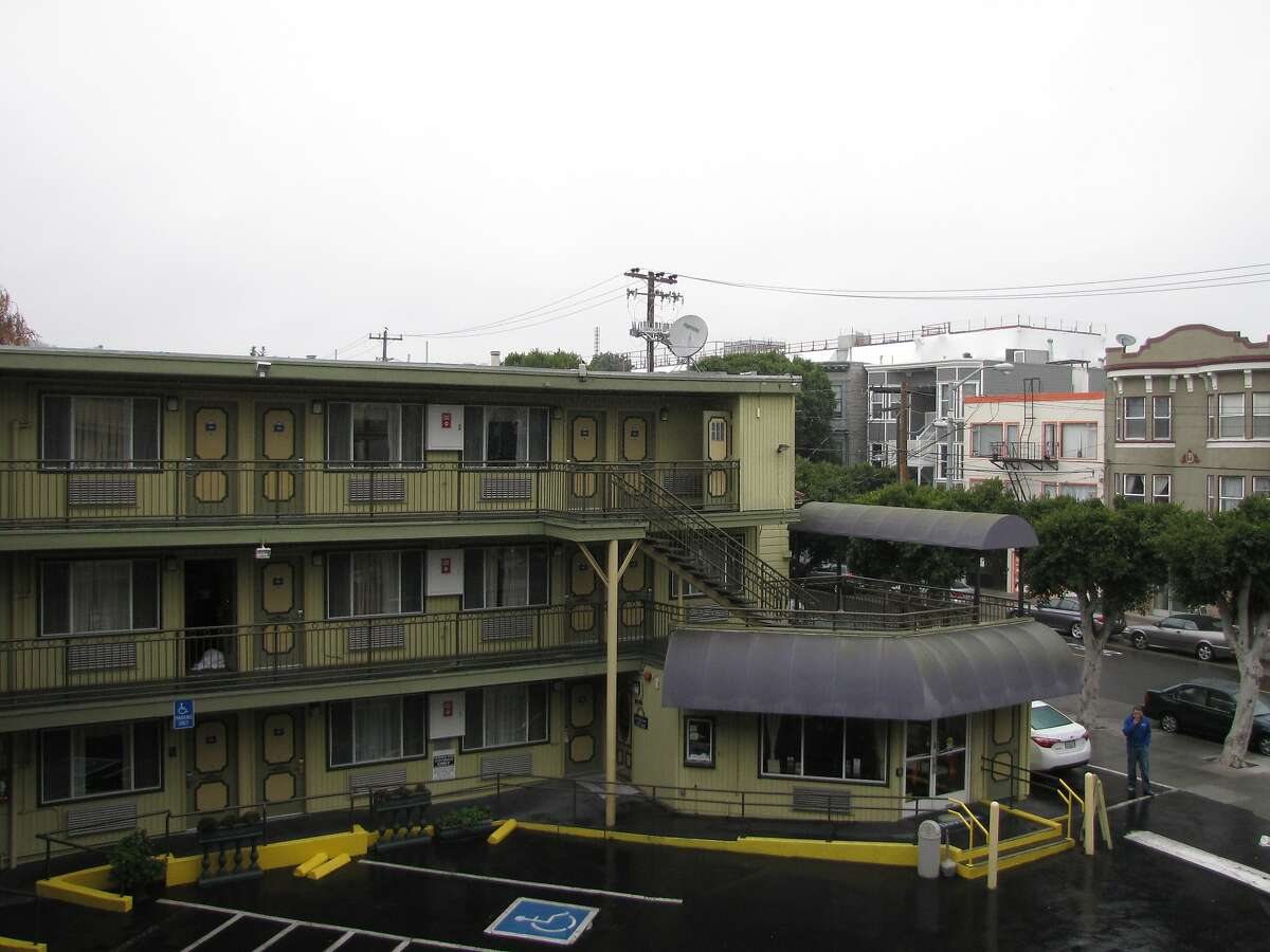 This motel was built in the late 1950s, around the same time the Central Freeway cut through Hayes Valley heading west and north, with an onramp from Gough Street alongside it. After the 1989 earthquake, those ramps eventually were removed -- but the motel remains even as the neighborhood is redeveloped around it.