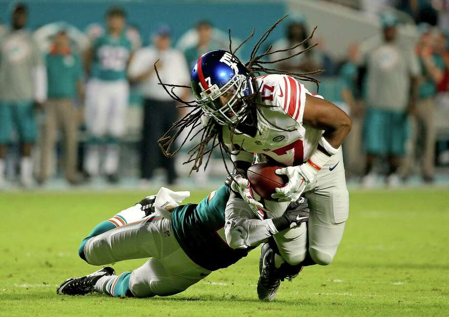Being brought down is a hair-raising experience for the Giants' Dwayne Harris against the Dolphins. Photo: Mike Ehrmann, Staff / 2015 Getty Images