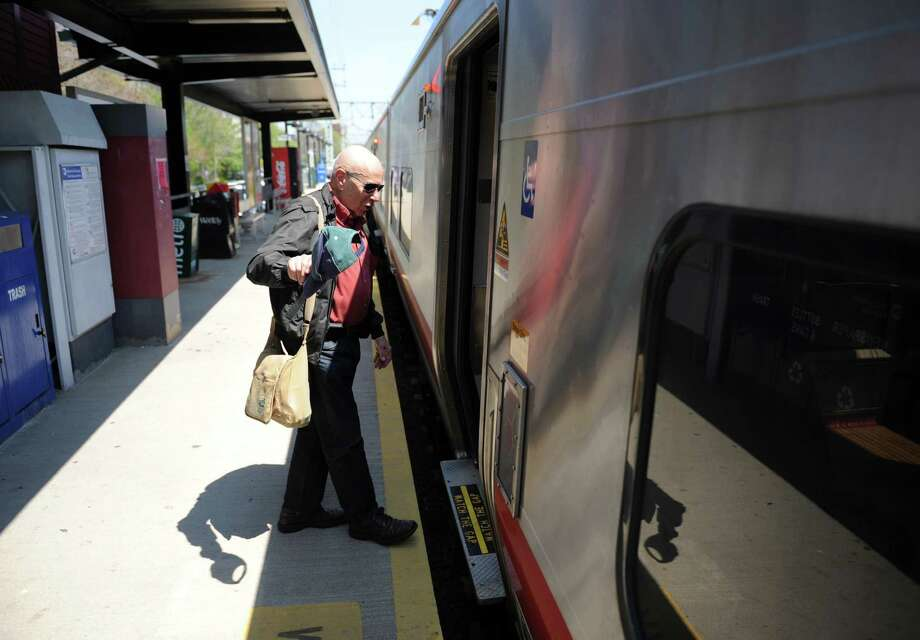 Commuter boards a Metro-North train. Photo: File Photo / Tyler Sizemore / Greenwich Time